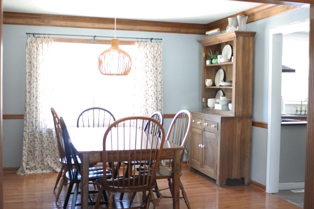 dining room with blue walls and dark wood trim