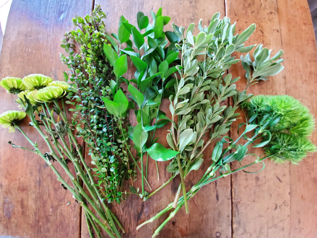 various green flowers and leafy stems for an all green flower arrangement