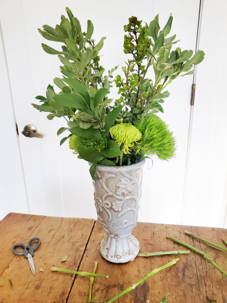 how to assemble a green flower arrangement, step 2, insert tall leafy stems