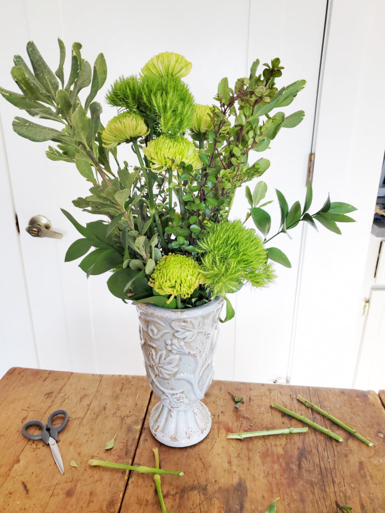 how to assemble a green flower arrangement, step 3, insert tall flower stems in center