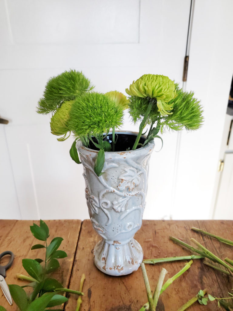 how to assemble a green flower arrangement, step 1, insert short flower stems