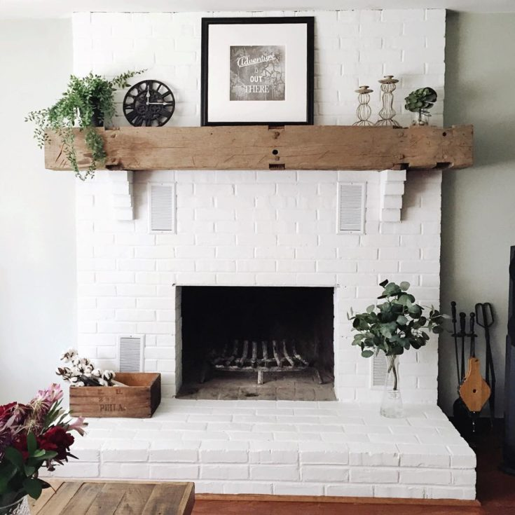 White Brick Fireplace with Rustic Wood Mantel