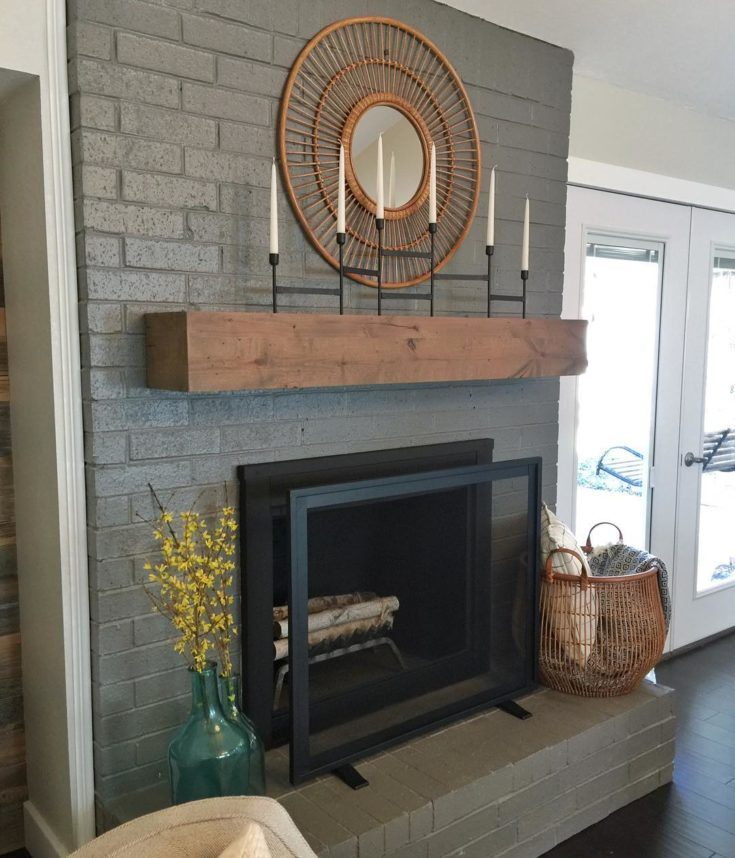 Gray Brick Fireplace with Rustic Mantel