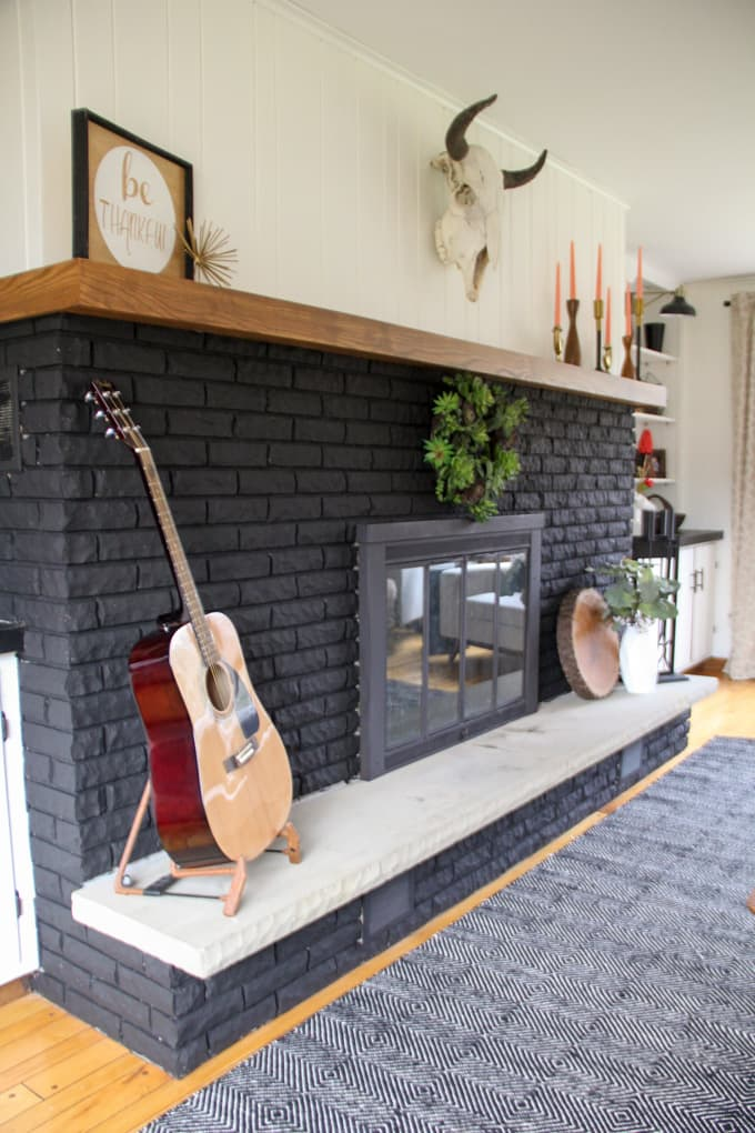 Black Brick Fireplace with Wood Mantel and Stone Hearth