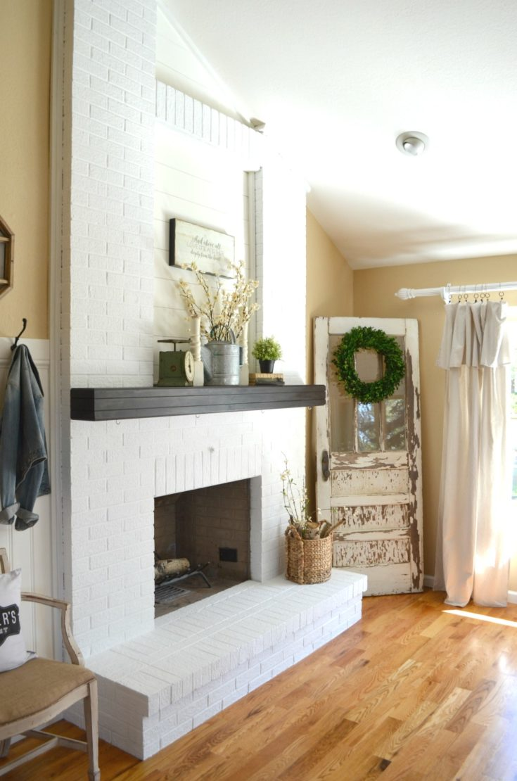 White Brick Fireplace with Shiplap Inset