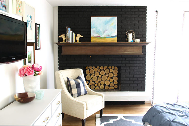 Modern Black Fireplace with Wood Mantel