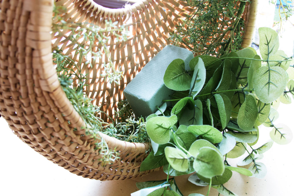 floral foam with eucalyptus in basket