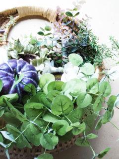 basket wreath with pumpkins and eucalyptus
