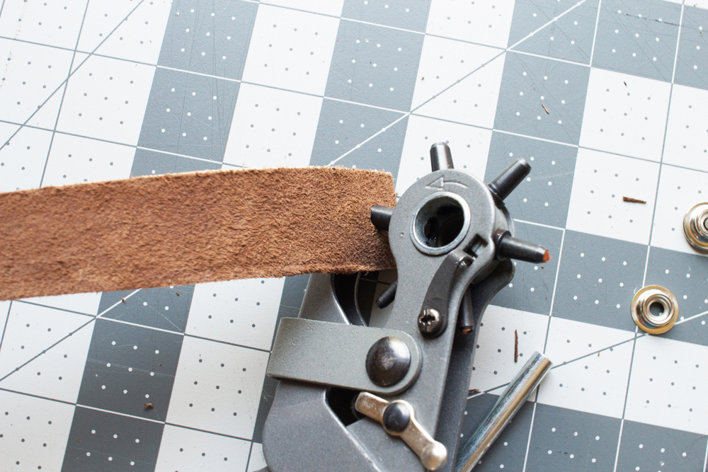 punch holes in leather with a leather hole punch tool