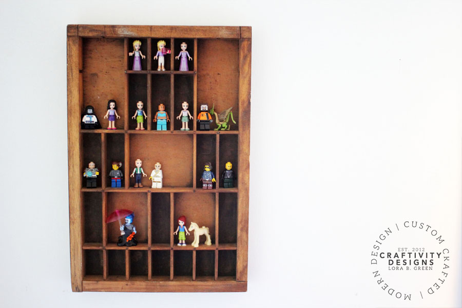 Display LEGO® Minifigures in a Vintage Printers Tray to organize small toys