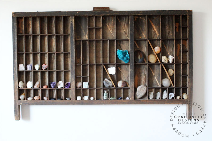 Display a rock collection in an antique printers tray or letterpress tray