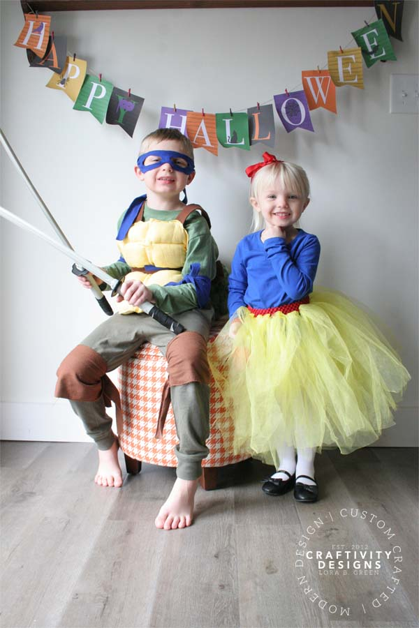 Children dressed for Halloween in a DIY Teenage Mutant Ninja Turtle Costume and a DIY Snow White Costume
