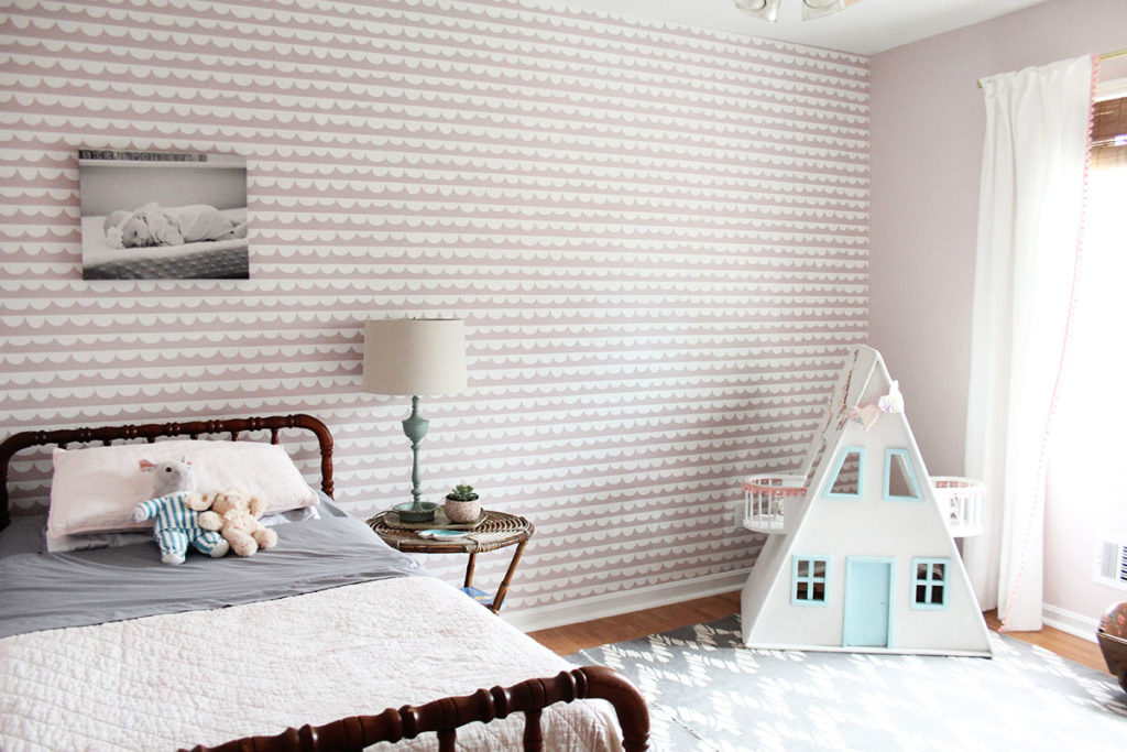 A Pink Girls Bedroom with antique bed, dollhouse, and gray rug by Craftivity Designs