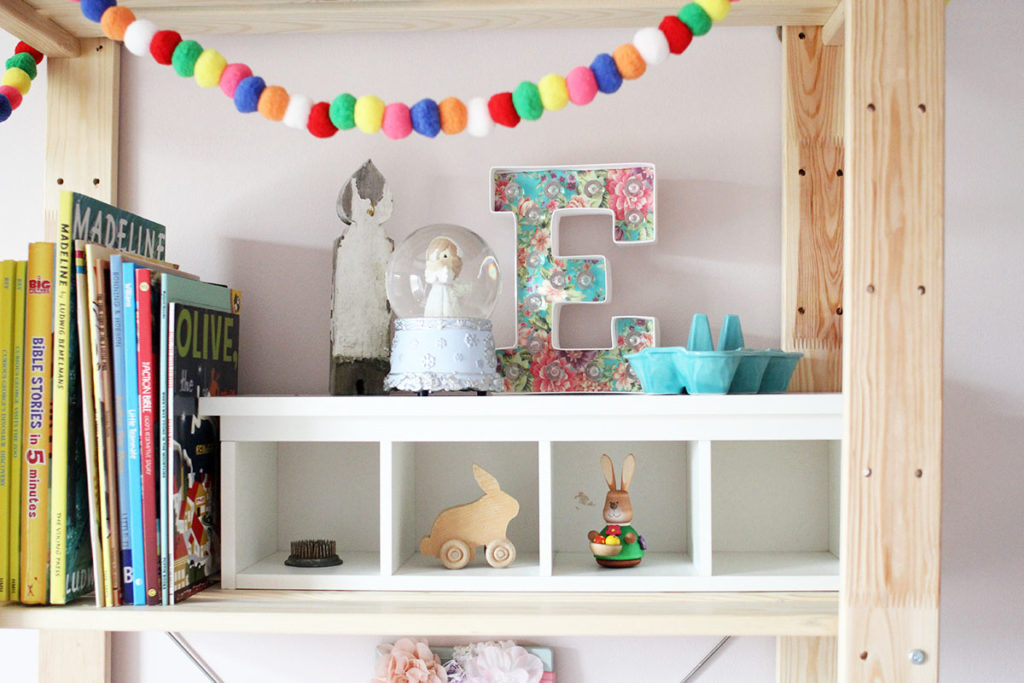 A wood bookshelf with colorful pom poms - little girl bedroom ideas - by Craftivity Designs