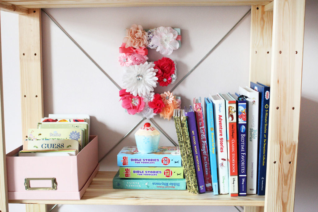 A wood bookshelf with a DIY floral monogram and books - little girl bedroom ideas - by Craftivity Designs