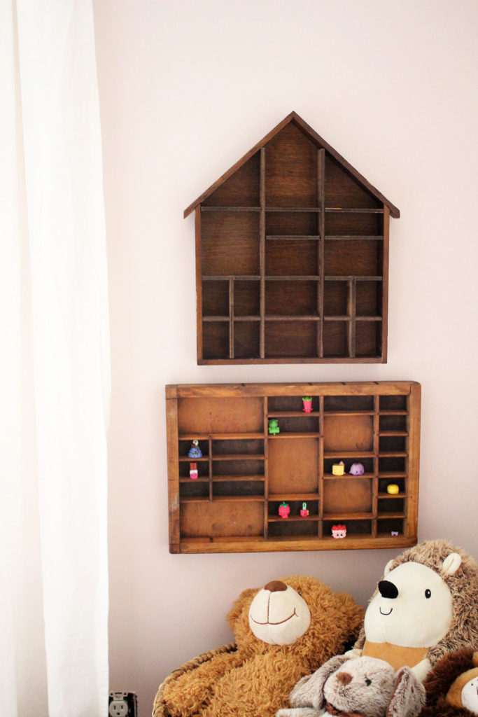 A pink bedroom with wood shadowboxes on the wall - ideas for a little girls bedroom - by Craftivity Designs