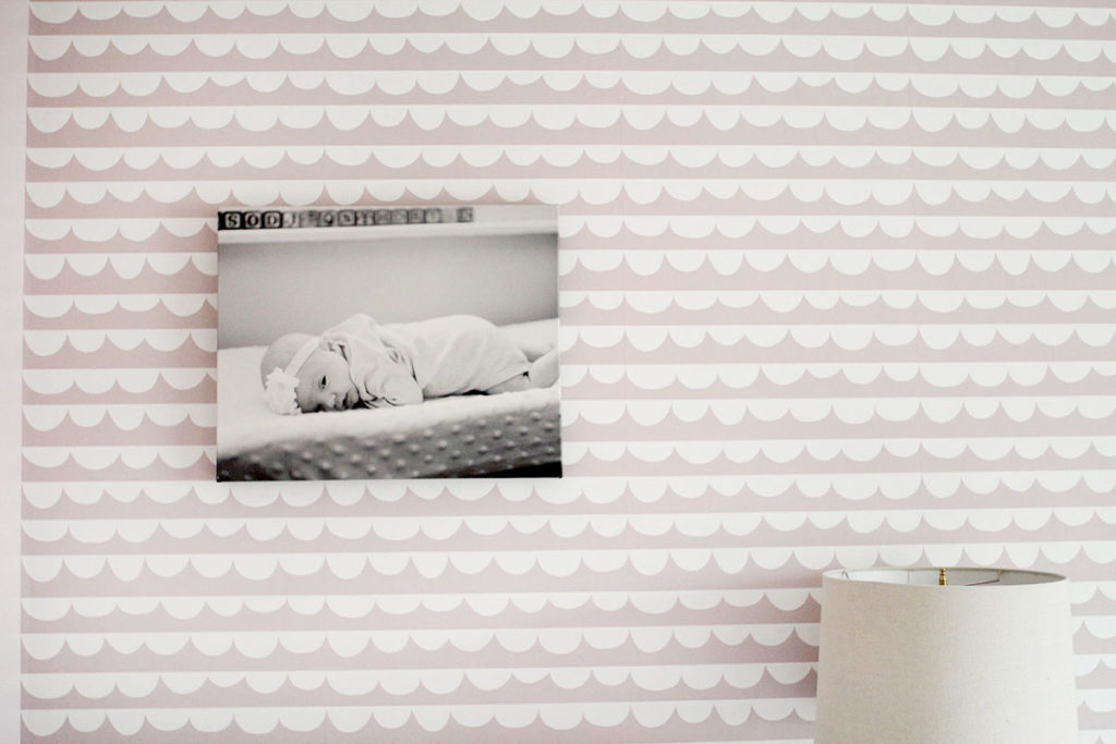 A pink bedroom with B&W print hanging on pink and white wallpaper - ideas for a little girls bedroom - by Craftivity Designs