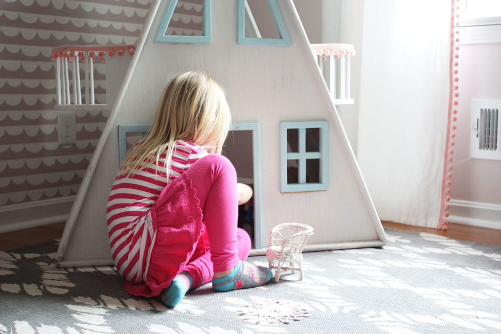 Child playing with wooden dollhouse - by Craftivity Designs