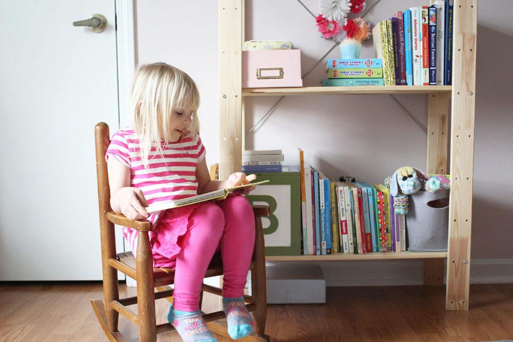 Child reading book in vintage rocker next to bookshelf, by Craftivity Designs
