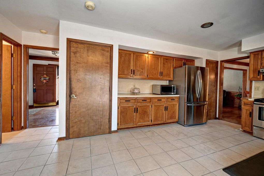 Before a Budget Kitchen Remodel, with Wood Cabinets, White Tile