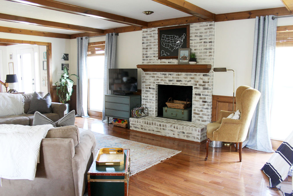 Living Room After Modern Cottage Remodel, Dark Beams, White Walls, and German Schmear Brick Fireplace, by Craftivity Designs