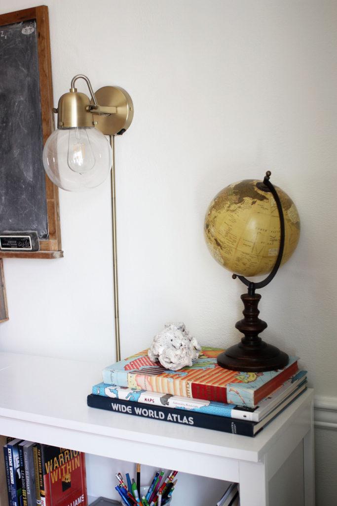 Vintage globe and vintage atlas in a homeschool room