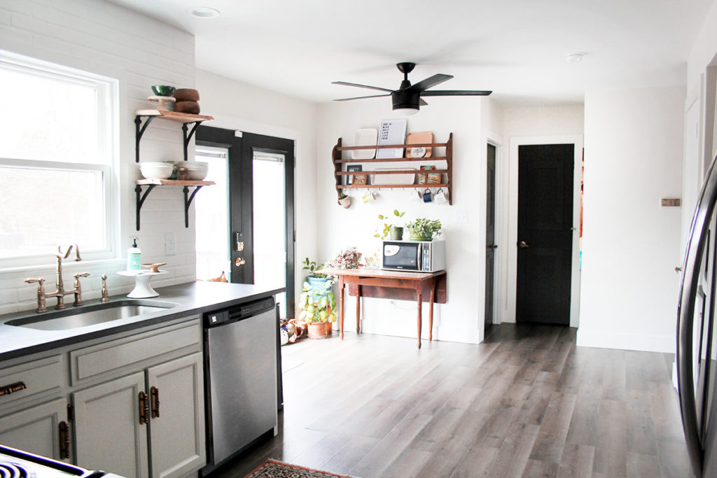Budget kitchen remodel with gray painted cabinets and dark interior doors