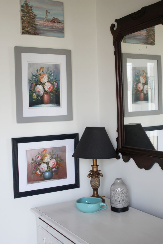 Entryway table with Antique Mirror, Vintage Floral Artwork, Pineapple Lamp and Black Lampshade