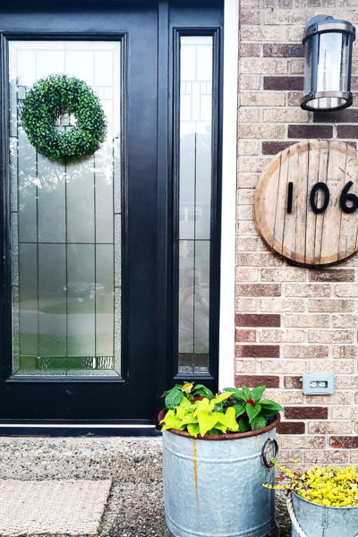 Bourbon Barrel Lid House Number Sign on Brick with Black Door by Craftivity Designs