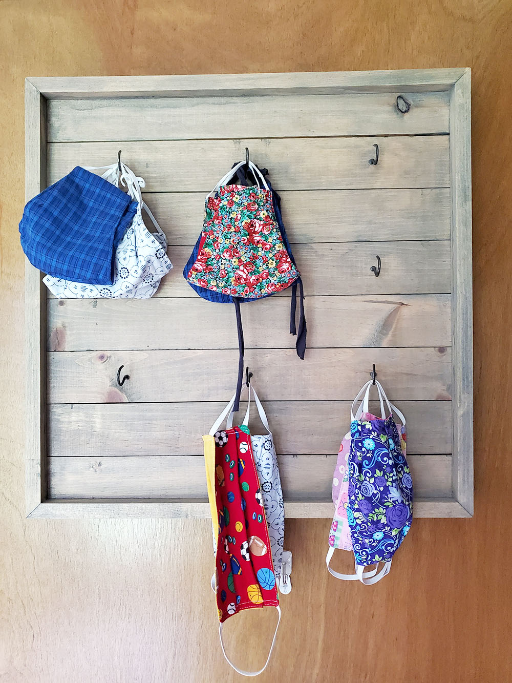 face mask organizer, cotton face masks on hooks