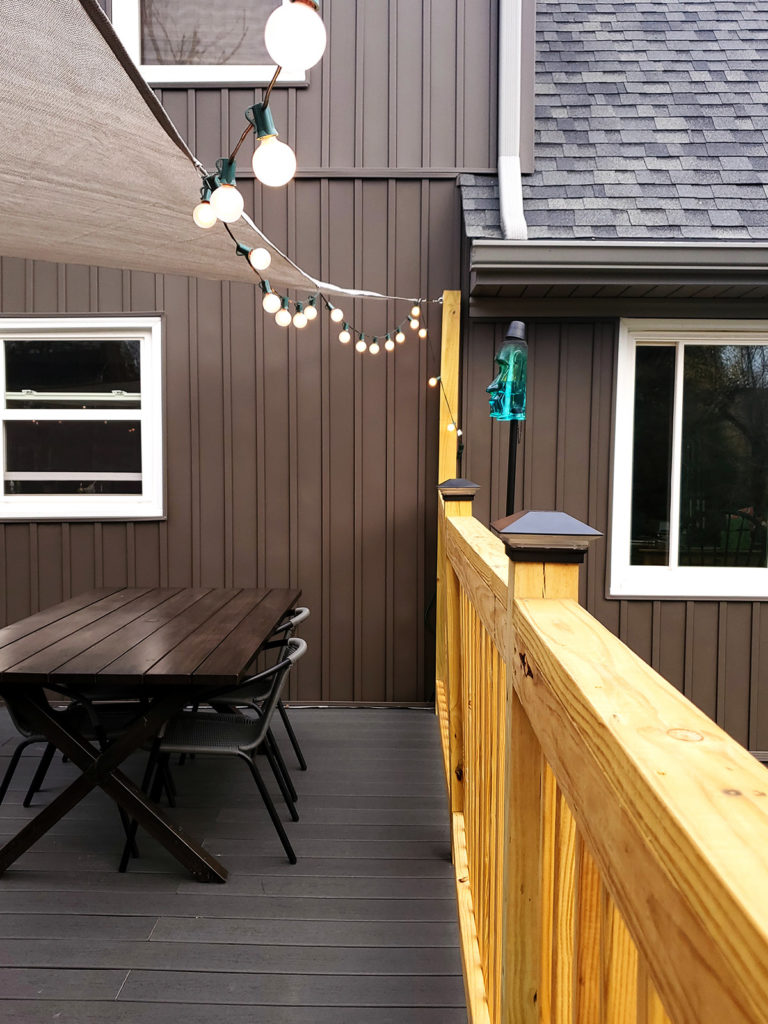 How to Install a Shade Sail, Shade sail with Patio Lights over a deck on a Modern Home