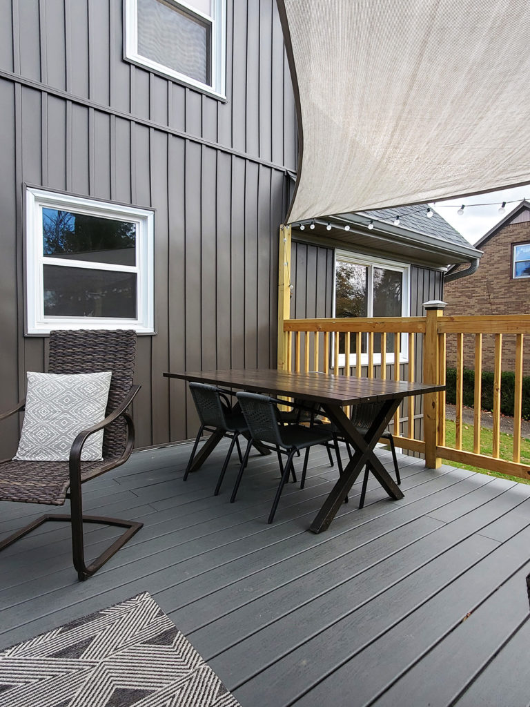 How to Install a Shade Sail, Shade Sail over a Gray Composite Deck