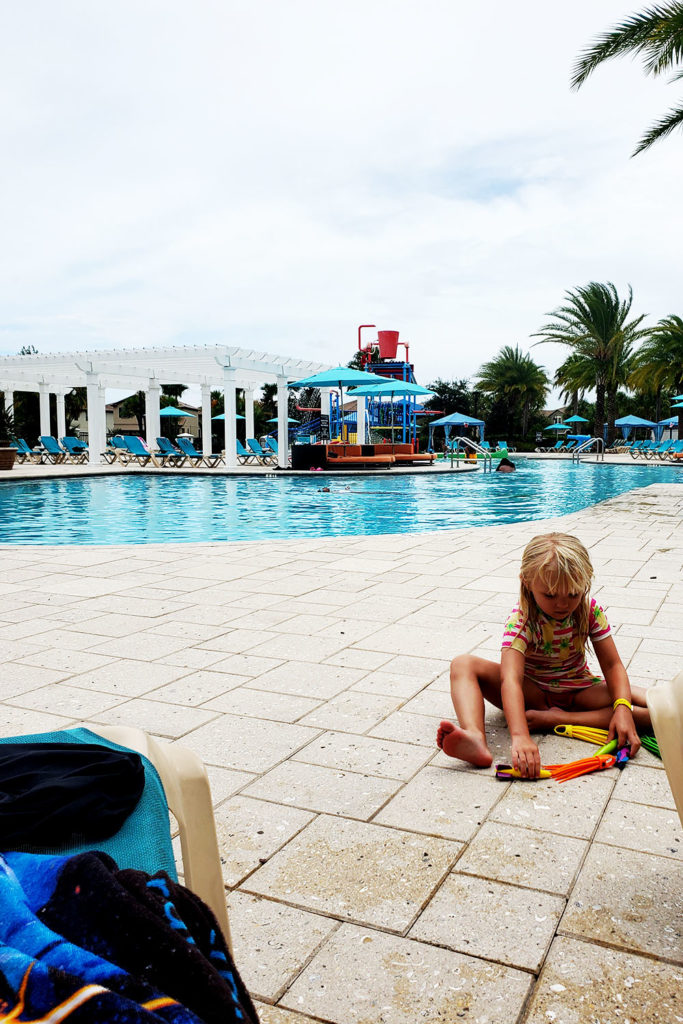 Child playing by the pool at Windsor at Westside Clubhouse