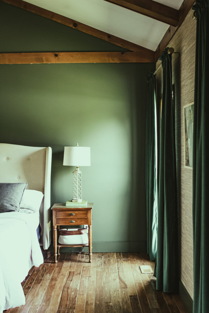 green baseboard painted trim with grasscloth wallpaper and green walls