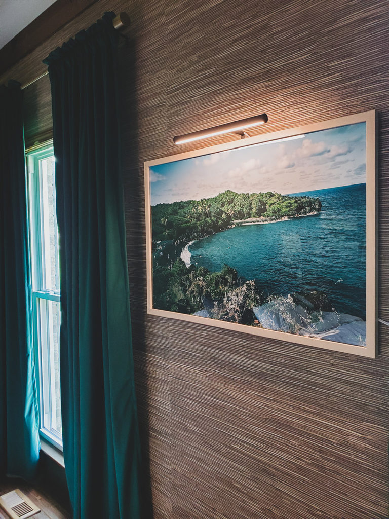 Large Hawaiian Art framed in Natural Wood on Grasscloth Wallpaper with Picture Light