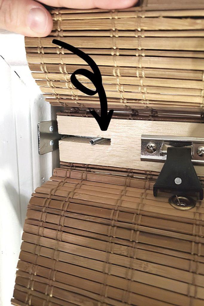 slide bamboo blind frame over screw