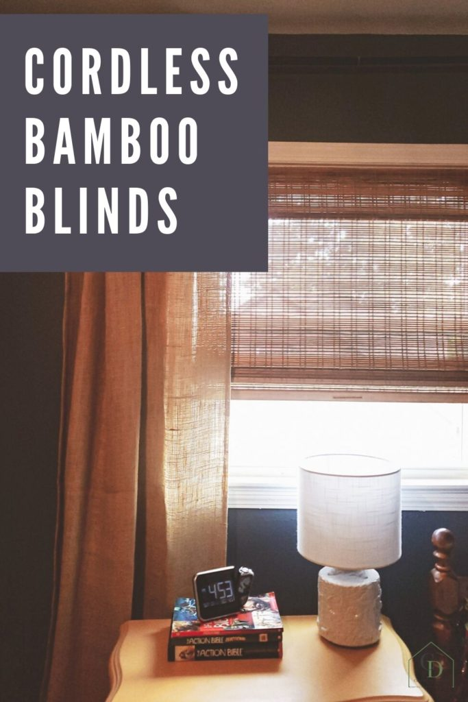 Cordless Bamboo Blinds in a boys bedroom with navy walls and yellow nightstand