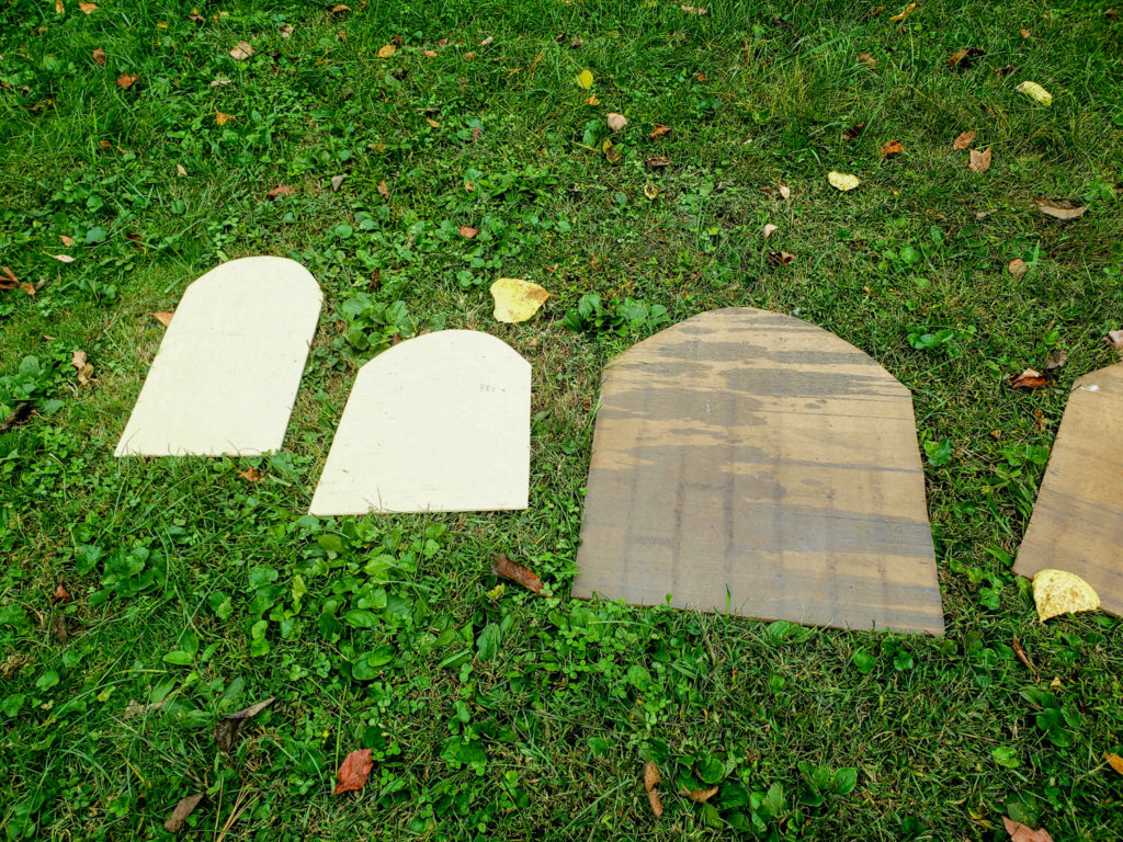 cut scraps of wood into tombstone shapes