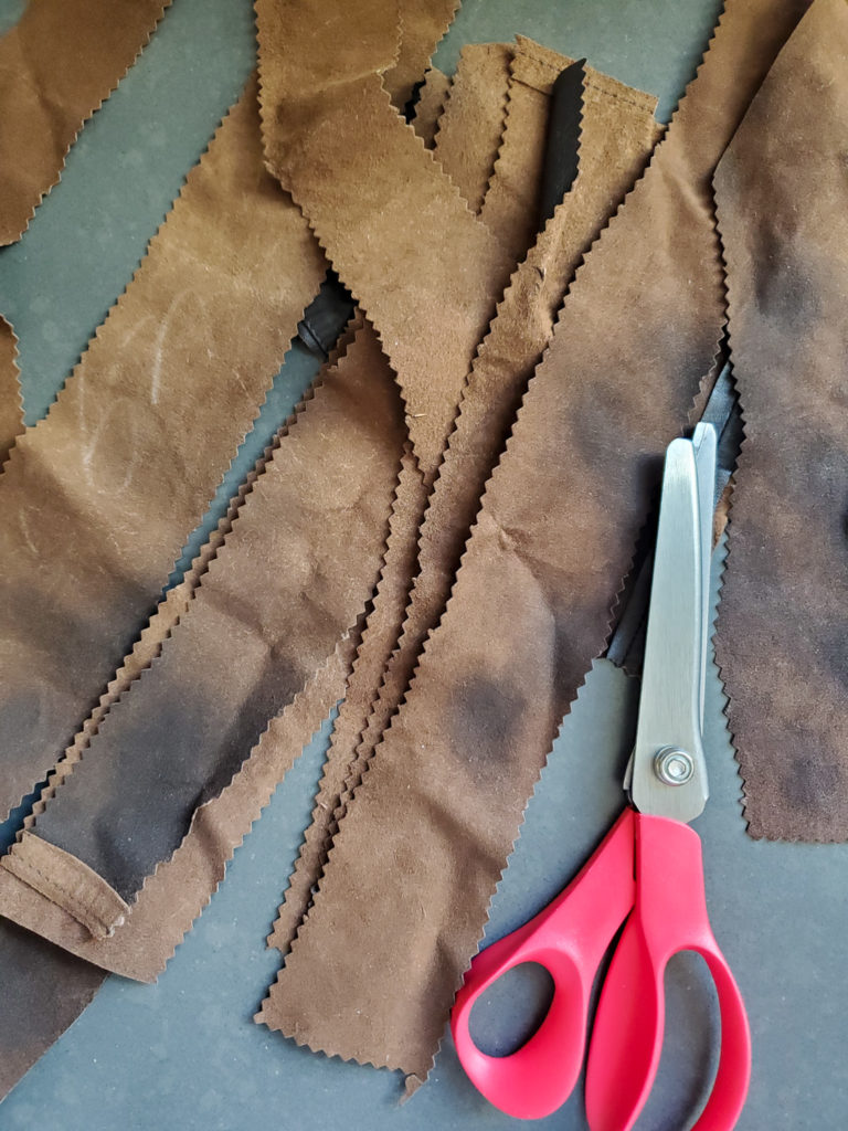 cut strips of leather with shearing scissors