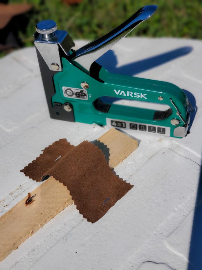staple leather strips to DIY halloween tombstones