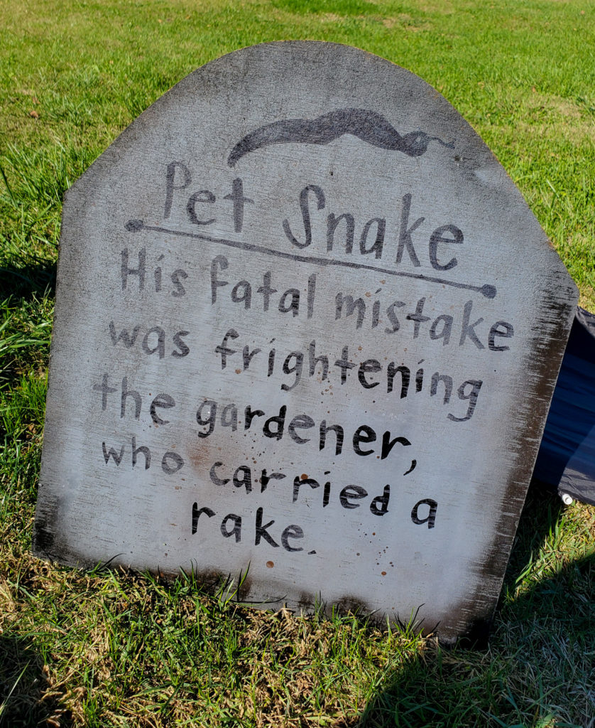 tombstone saying - pet snake his fatal mistake was frightening the gardener who carried a rake
