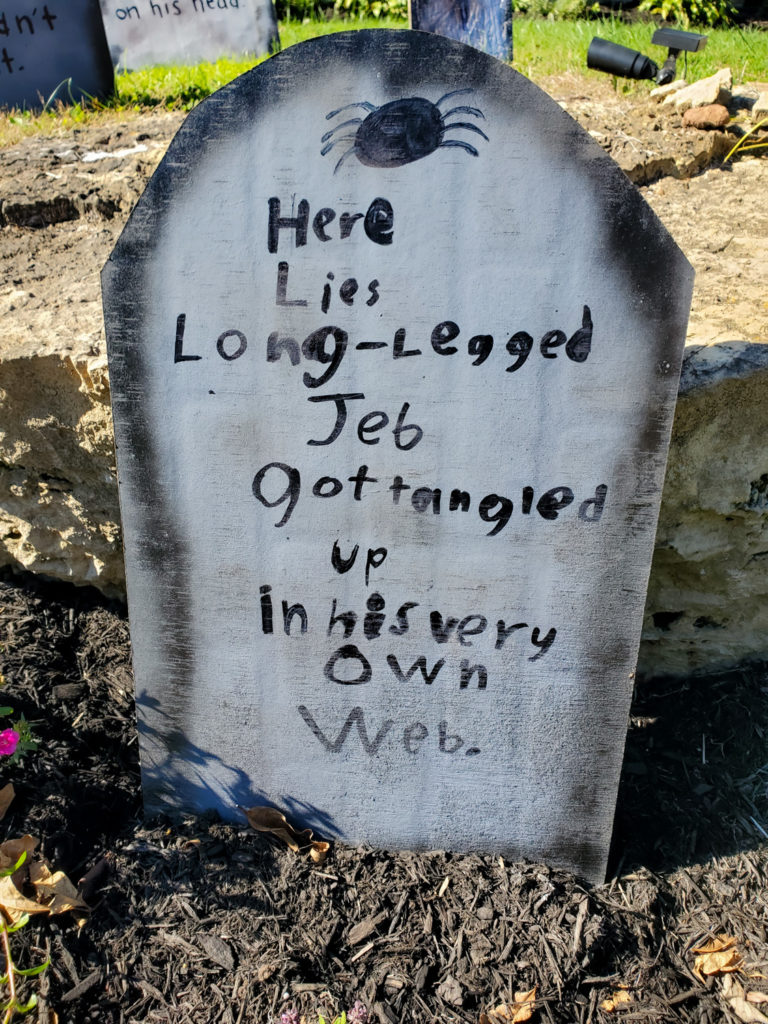 tombstone saying - here lies long legged jeb got tangled up in his very own web