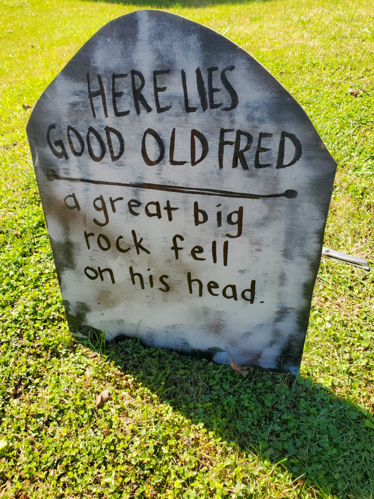 tombstone saying - here lies good old fred a great big rock fell on his head